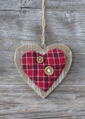 Heart over a wooden background — Stock Photo