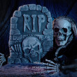 Skull monster and tombstone - Stock Photo