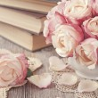 Stock Photo: Pink roses and old books