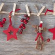 Wooden christmas deer and red stars — Stock Photo