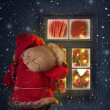 Santa Claus looking through a  window - Stock Photo