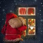 Santa Claus looking through a window — Stock Photo