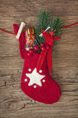 Red sock with chocolate Krampus — Stock Photo