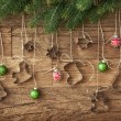 Cookie cutter and christmas baubles — Stock Photo #14811937