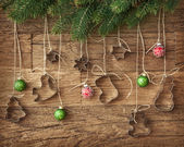 Cookie cutter and christmas baubles — Stock Photo