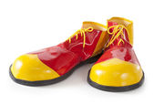 Red and yellow clown shoes — Stock Photo