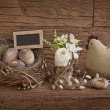 Easter eggs in nest and flowers — Stock Photo #22339183