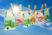 Money laundering on clothesline — Stock Photo