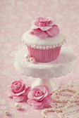 Cupcake with rose flower — Stock Photo