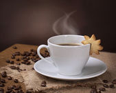 Cup of coffee with cookie — Stock Photo