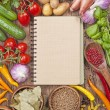 Assortment of fresh vegetables and blank recipe book — Stock Photo