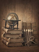 Stack of books and globe — Stock Photo