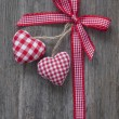 Red ribbon with hearts — Stock Photo