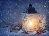 Burning lantern and christmas decoration — Stok fotoğraf