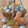 Stock Photo: Easter cookie and blue eggs