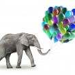 Elephant with a colorful balloons — Stock Photo