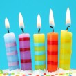 Five birthday candles on blue background — Stock Photo #5566540