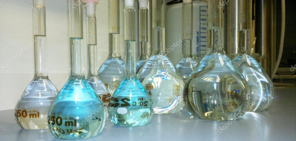 Bottles filled with liquid in a lab for background use — Stock Photo #17176239