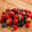 Stock Photo: Berries on Wooden Background.