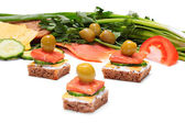 Light and tasty snack of bread, cheese, smoked salmon and olives. — Stock Photo