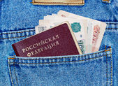Money and passport in the back pocket of jeans — Stock Photo