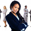 Full length image of a pretty African American business woman over white, colleagues at the back  — Stock Photo