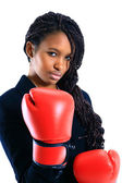 Young African American woman wearing boxing gloves — Stock Photo