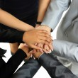 Image of business partners hands on top of each other symbolizing companionship and unity — Stok fotoğraf