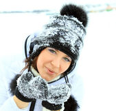Portrait of beautiful woman with snow in her palm — Stock Photo