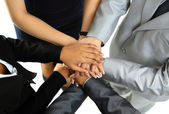 Image of business partners hands on top of each other symbolizing companionship and unity — 图库照片