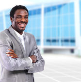 Happy young african american businessman in office — Stock Photo
