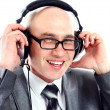 Businessman wearing earphone struggling to hear. Communication concepts. — Stockfoto