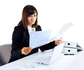 Portrait of a businesswoman with paperwork at office desk — Stock Photo