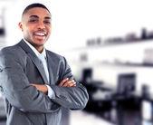 Porträtt av en stilig framgångsrikt företag man upptagen arbetar på hans kontor — Stockfoto