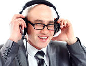 Businessman wearing earphone struggling to hear. Communication concepts. — Stock Photo