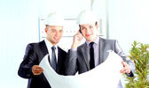 Architect engineer two expertise team plan talking hardhat — Stock Photo