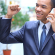 Happy young african american businessman on mobile phone — Stock Photo