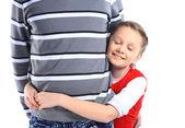 Niña abrazando a su padre - aislado sobre un fondo blanco — Foto de Stock