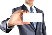 Business man holding blank business card isolated on white — Stock Photo