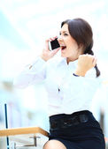 Smiling businesswoman talking on the phone as winner and laeader — Stock Photo