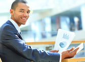 Businessman using digital tablet computer with documents. New technologies for success workflow concept. — Stock Photo