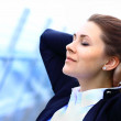 Portrait of cute young business woman relaxing outdoor — Stock Photo