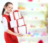 Picture of beautiful girl with gift boxes — Stock Photo