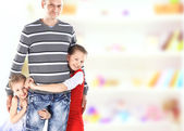 Portrait of daddy with little girls — Stock Photo