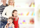 Portrait of beautiful smiling happy family of four - isolated over a white background — Stock Photo