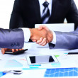 Two business colleagues shaking hands during meeting — Stock Photo