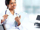 Beautiful african american female pediatric nurse in modern office — Stock Photo