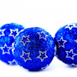 Blue christmas balls with sample text — Stock Photo