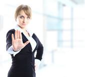 Blond businesswoman with stop hand sign gesture isolated on white. Business concept. Studio shot. — Stock Photo