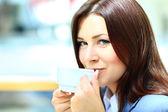 Businesswoman on a coffee break in modern urban cafe — Stock Photo